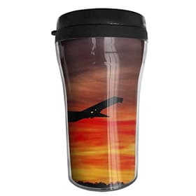 taza portatil de cafe de avion atardecer